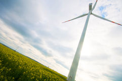Wind turbine on green field Stock Images