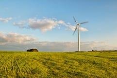 Wind turbine in green field Royalty Free Stock Photos