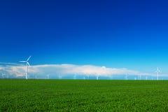 Wind turbine in green field Stock Photography