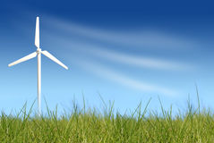 Wind turbine on green field Royalty Free Stock Photography