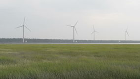 Wind turbine on a green field stock video footage