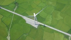 Wind turbine on green field aeria view from drone. Alternative natural source and ecology conservation. Wind farm, green