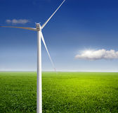 Wind turbine on a green field Royalty Free Stock Images