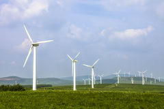 Wind turbine on the green grass Royalty Free Stock Photos