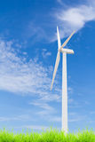 Wind turbine on green grass with blue sky Royalty Free Stock Photos
