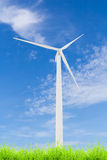 Wind turbine on green grass with blue sky Royalty Free Stock Photography