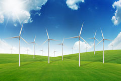 Wind turbine on green grass field Royalty Free Stock Images
