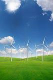 Wind turbine on green grass field Stock Image