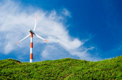 Wind turbine in green hill Stock Photo