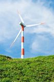 Wind turbine in green hill Stock Images