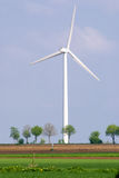 Wind turbine in a green landscape Royalty Free Stock Photo