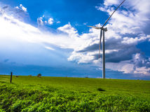 Wind turbine. On green meadow Stock Images