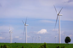 Wind turbine on the green meadow Stock Images