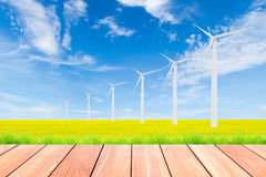 Wind turbine on green rice field against blue sky background Royalty Free Stock Photography