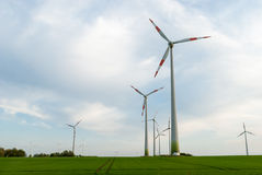 Wind turbine. Group of windmill generators in Germany Stock Images