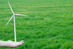 Wind turbine in hand Royalty Free Stock Image