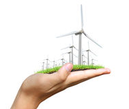 Wind turbine in the hand Royalty Free Stock Images