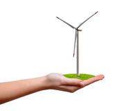 Wind turbine in hand. Isolated on white Stock Image