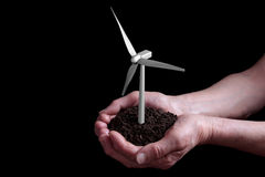 Wind turbine in hands Royalty Free Stock Photo