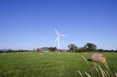 Wind turbine and hay bails Stock Photography