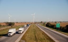 Wind turbine and highway Stock Images