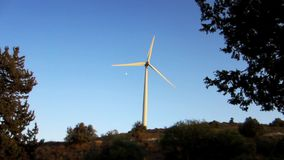 Wind turbine. On the hill with blue sky background stock footage