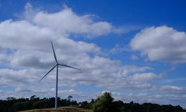 Wind turbine in the hill. Wind turbine with mountain view Stock Image