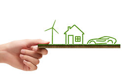 Wind turbine, house and a car concept of ecology Royalty Free Stock Photography
