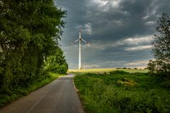 wind turbine is illuminated by the sun royalty free stock images