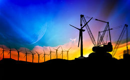 Wind turbine installation. Silhouette Mobile cranes installed a wind turbine Royalty Free Stock Photos