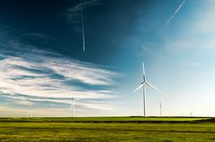 Wind turbine on land background Royalty Free Stock Image
