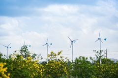 Wind turbine landscape natural energy green Eco power concept at wind turbines farm blue sky. Background stock photography