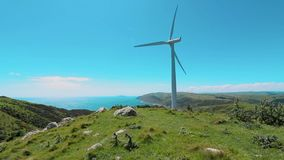 Wind turbine live footage. One wind turbine farm In New Zealand stock video footage
