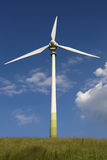 Wind turbine on a meadow green energy Royalty Free Stock Photos