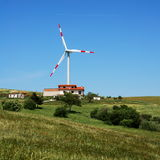 Wind turbine and modern house Royalty Free Stock Images