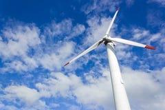 Wind turbine. Modern wind turbine under blue sky Royalty Free Stock Image