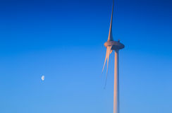 Wind turbine and moon Stock Images
