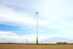 Wind turbine with motion blured blades. Stock Photos