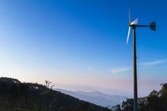 Wind turbine on mountain at sunrise Stock Photo