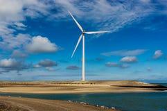 Wind turbine near the North Sea. Wind turbine in a entering brunch of sand near the North Sea Stock Photos