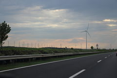 Wind turbine next to the motorway Stock Photography
