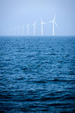 Wind turbine in the northern sea from afar Stock Images