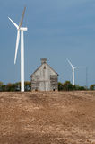 Wind turbine and old barn Stock Photos