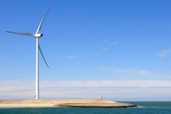 Wind Turbine On Coast Stock Photo