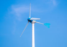 Wind turbine on the over the blue sky. A Wind turbine on the over the blue sky Stock Images