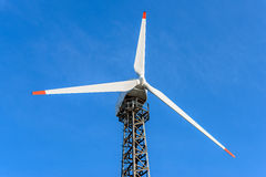 Wind turbine over blue sky background. On a sunny day Stock Photography