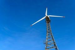 Wind turbine over blue sky background Stock Photo
