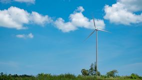 Wind turbine over the blue sky and clouds. Wind turbine over the blue sky and clouds Royalty Free Stock Photography
