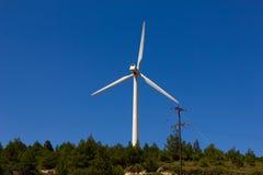 Wind turbine over the blue sky Stock Photo