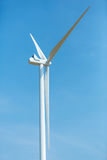 Wind turbine over a deep blue sky. Renewable energy concept Royalty Free Stock Photography
